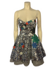 Silver paillette, fit & flare, sleeveless dress with blue, red, green, & white, round, rhinestone appliques. Silver, pleated underskirt.