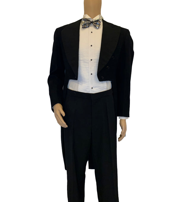 Black, tuxedo tailcoat with wide peak lapels, six buttons at the front, and four buttons at each sleeve.