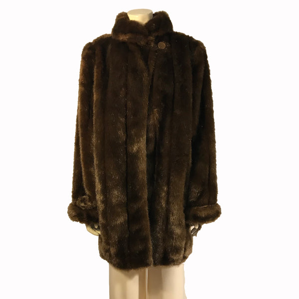Dark brown, faux fur, oversized, knee-length coat with a high collar and wide cuff sleeves.