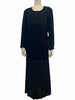 Black, floor-length, paneled dress with long sleeves and black buttons.