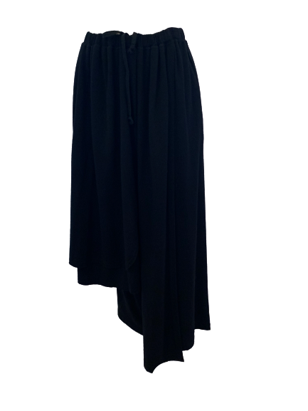Asymmetrical wool skirt with elasticized  gathered waist. and cutout details on either side. Can be worn as a strapless dress if pulled up over bust.