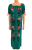 Front view of mannequin wearing Mexican aqua blue long dress with floral cross stitch embroidery