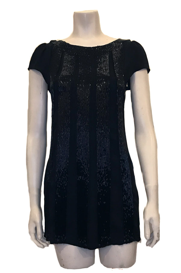 Black, a-line dress with vertical, wide, black-beaded stripes down the front & back.