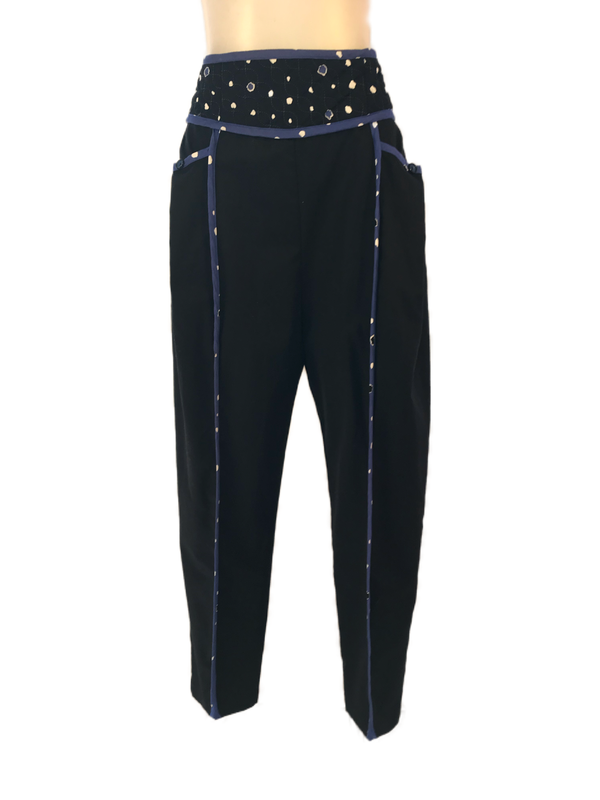 Front view of women's 80s pants by Jeanne Marc featuring a quilted waistband and blue trim