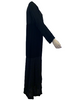 Black, floor length, paneled dress with long sleeves.