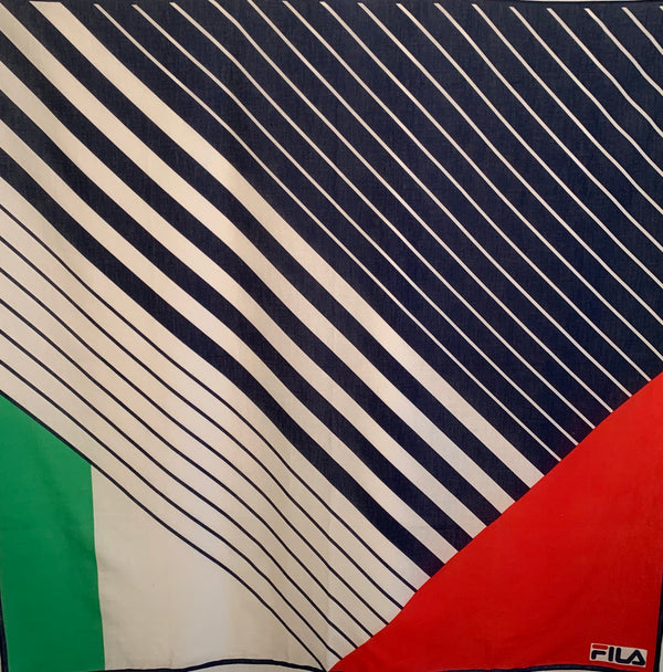 Square cotton scarf with navy and white stripes and 2 triangle patterns in white. green and red. Signed FILA in bottom right corner