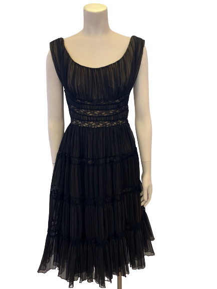 Front view of a 1950s black lace dress on a mannequin