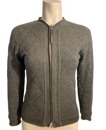 Grey quilted wool sweater with zipper front. Waist length