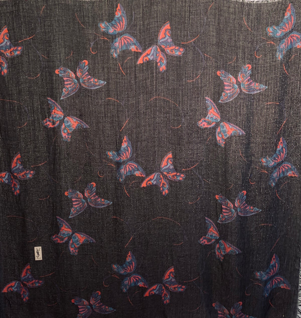 Oversized Black and metallic woven scarf with a print consisting of red and purple butterflies.