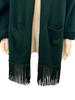 Dark green, cropped, knit cardigan with long, fringed, shawl collar and pockets.