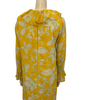 Back view of a mannequin in a long sleeve 1960s mini dress with ruffles at the neck, front, and sleeves. The dress is yellow with white and green flowers on it