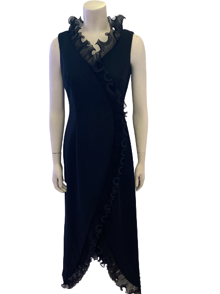 Front view of mannequin in 1970s sleeveless black maxi dress with ruffles at the neck and hem