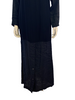 Black, floor length, paneled dress with long sleeves and black buttons.
