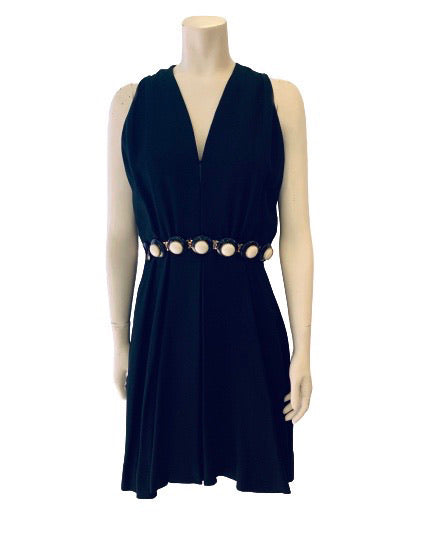 Black, heavy-linen, sleeveless, knee-length dress with an attached white, gold, and black beaded belt.