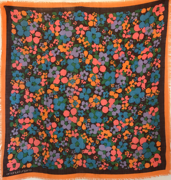 Emanuel Ungaro scarf with a floral print in coral, periwinkle, blue, orange, and green.