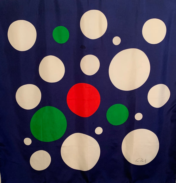 Square silk scarf with navy background and white, green and red polka dots.