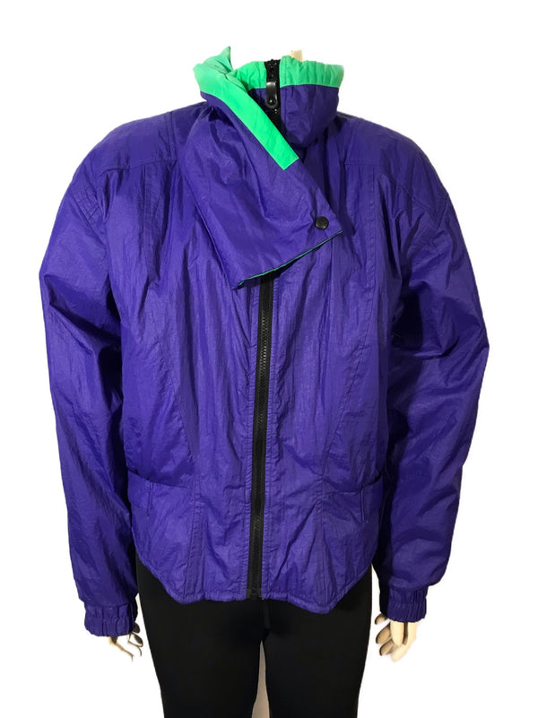 Purple nylon ski jacket with green accent at neck. Hip length zip up front and high funnel neck collar.