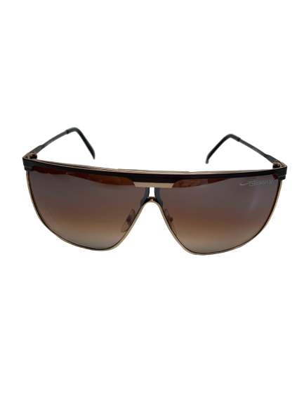 Metal frame aviator style sunglass with wood trim along top and Gavonni signature on amber lenses