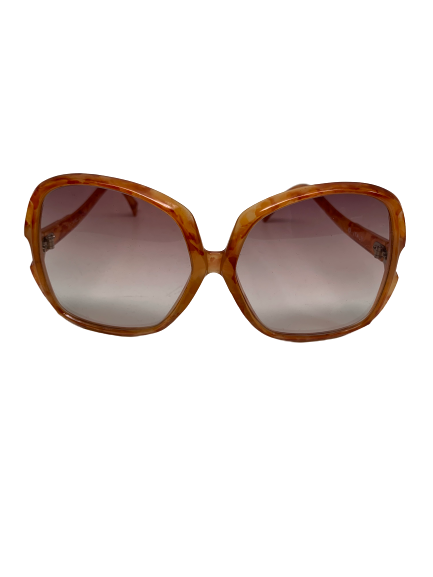 Front view of 1970s orange tortoise large frame sunglasses with  grey lenses