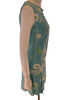 Side view of a mannequin wearing a light blue sleeveless mini dress with a white and green floral pattern