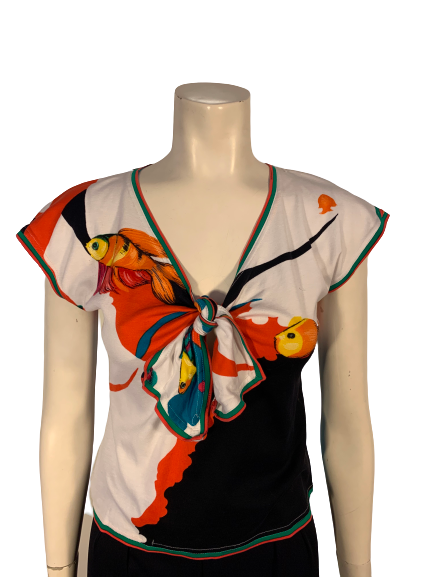 Short-sleeve, v-neck shirt with an all-over fish print in blue, green, black, white, orange, and red.