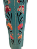 Side view of mannequin wearing Mexican aqua blue long dress with floral cross stitch embroidery