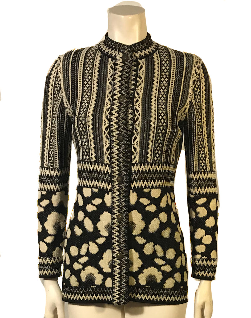 Cream, white and black  long sleeve cardigan sweater with a striped pattern on top and an animal print pattern on the bottom