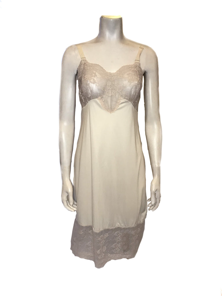 Front view of mannequin wearing a vintage beige slip