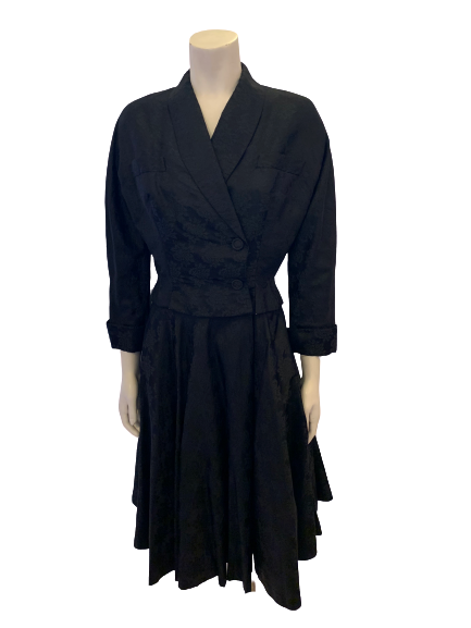 Front view of a mannequin in a black double breasted jacket and circle skirt
