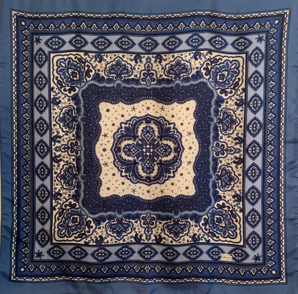 Silk scarf with blue and creme, paisley motif.