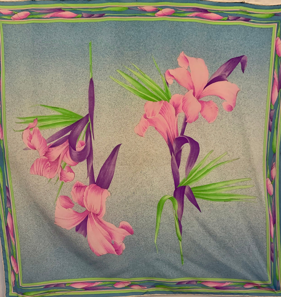Square silk scarf with floral pattern in blue, pink, purple and green