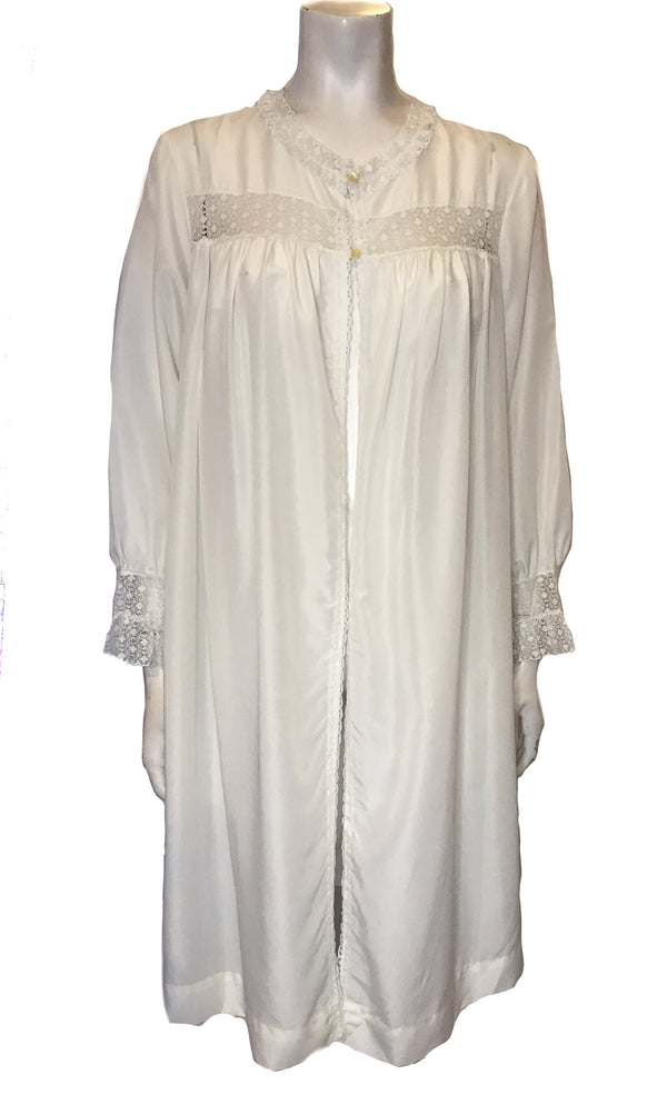 Front view of mannequin wearing long sleeve white robe with lace