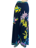 Black, high-waisted, wide-leg pants with a lime green, purple, aqua, and pink flower print.