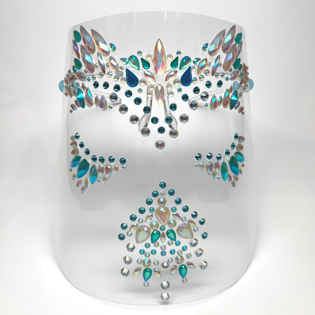 Clear plastic face shield with pearlescent white and blue rhinestones and blue crystals. Shield is worn on face with 2 arms that rest on the ears.