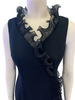 Closeup Front view of mannequin in 1970s sleeveless black maxi dress with ruffles at the neck and hem