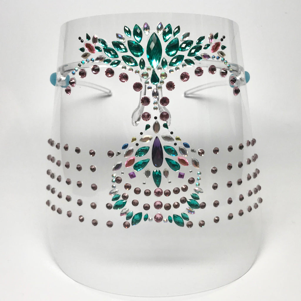 Clear plastic face shield with multicolored rhinestones and light pink crystals  Clear plastic arms rest on the ears.