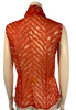 Sheer orange sleeveless blouse with scarf tied in bow at neck. Pattern is an orange and cream abstraction
