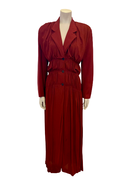Rust color, ruched, floor-length dress with three buttons, notched lapel, and long sleeves.