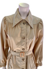 Closeup view of mannequin in a 1970s Beige Trench Coat with a round yoke and pointed collar