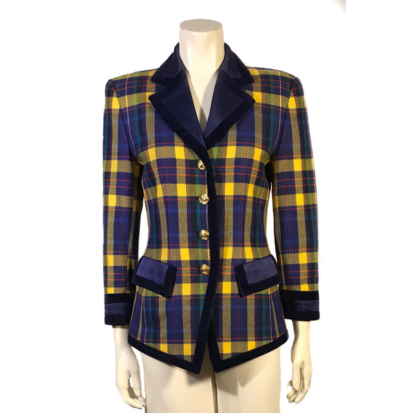 Front view on mannequin a plaid jacket with long sleeves, two front pockets and gold buttons. Plaid is yellow, blue, red