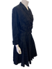 Side view of a mannequin in a black double breasted jacket and circle skirt