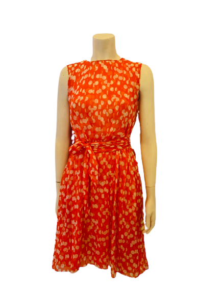 Sheer, orange & white polka-dot, sleeveless dress with waist-tie.