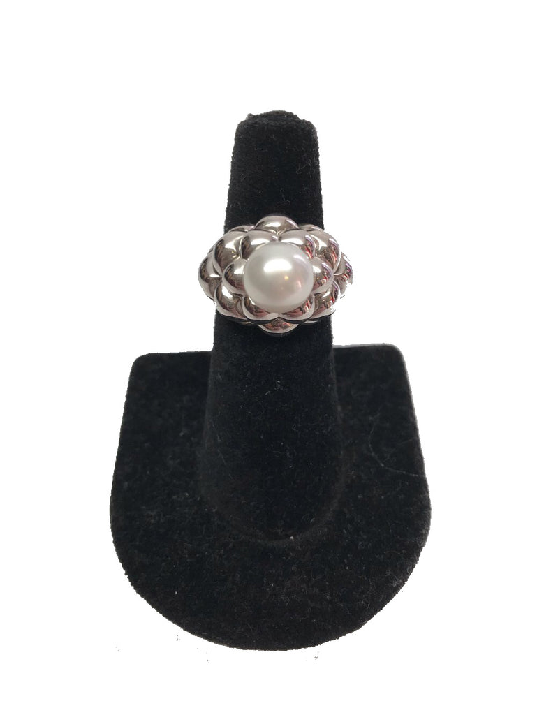 Front view of finger display with a silver and pearl cocktail ring