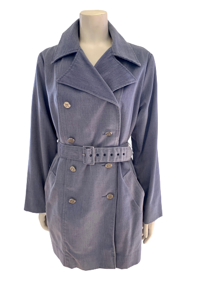 Front view of a mannequin in a denim double breasted trench coat with a belt
