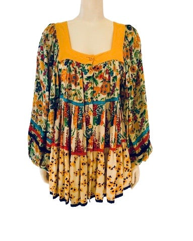 Colorful, tiered, floral mini dress with billowy sleeves and buttons up front.