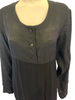Black, paneled dress with long sleeves and black buttons.