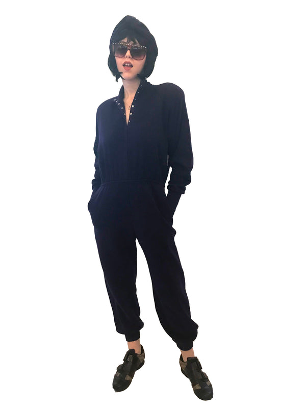 Cotton, fleece-lined, purple, sweatshirt-jumpsuit with snap-front, elasticized-waist, and ribbed cuffs & ankles.