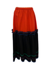 Red & black, two-tier, long-skirt with green, purple, and blue ric-rac.