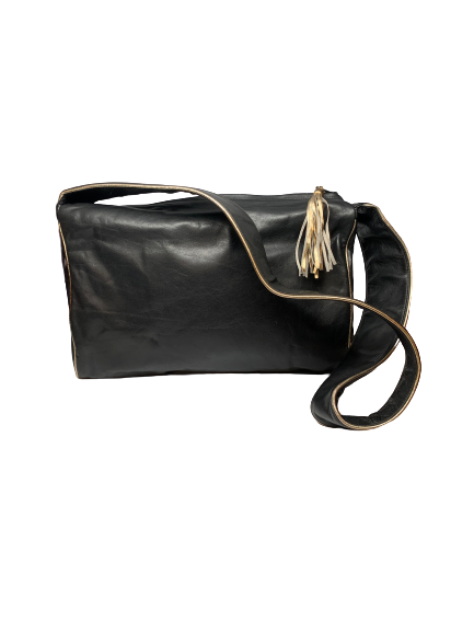 Black, leather bag with long strap, gold piping, and a gold tassel.