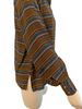 Side view of mannequin in a long sleeve blouse with brown, orange, white and blue horizontal stripes